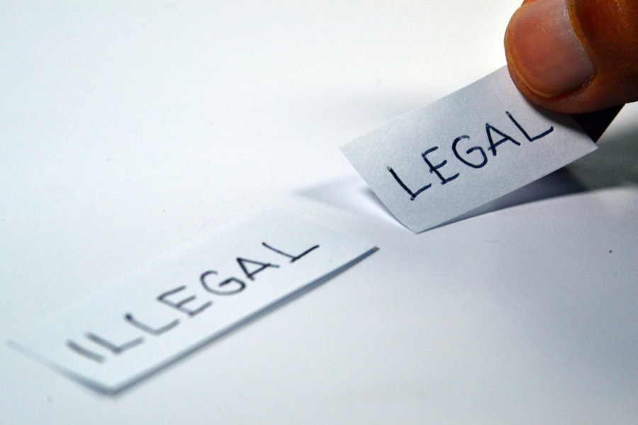 legal and illegal word on a piece of paper