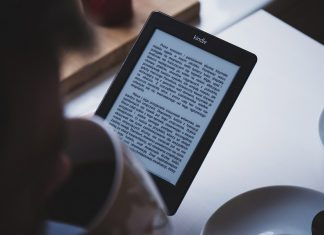 Reading a story on tablet while drinking coffee